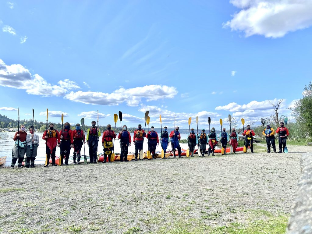 Kids lining up for a photo after a fun safety training program